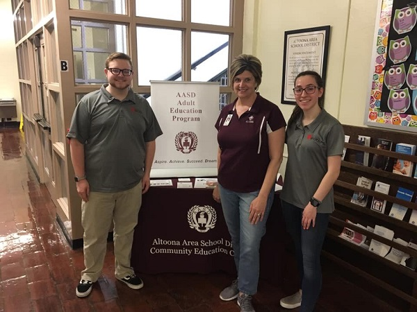 Uwork team members Hunter Longenecker (left) and Morgan Flack (right) with AASD Adult Education Program Director Tina Swineford.